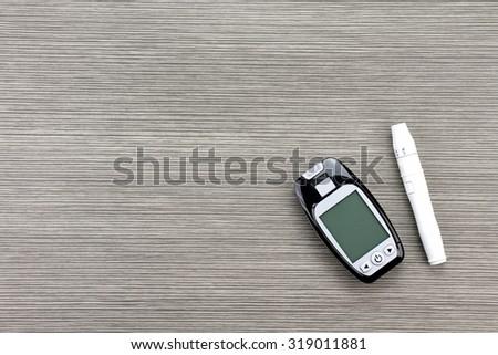 Blood sugar measurement, Diabetic kit, Syringe pen with insulin and glucometer, Blood glucose test, Blood glucose meter kit. - stock photo