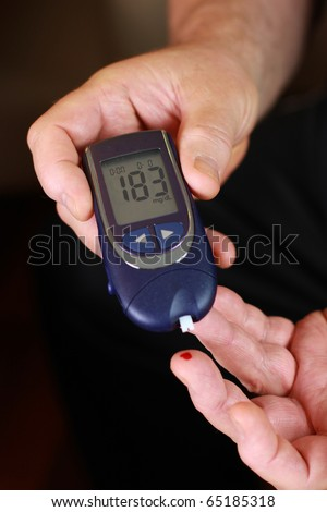 Blood sugar test - diabetic person - stock photo