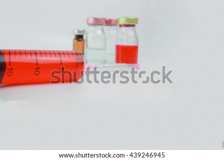 Blood  syringes and  blurred background vials in the hospital. : medication,vaccine, drugs, blood, laboratory with Copy space. - stock photo