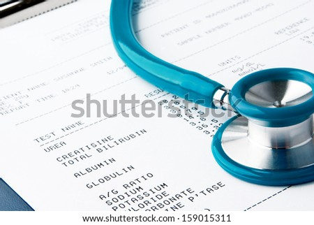Blood test results with a clipboard with stethoscope  - stock photo