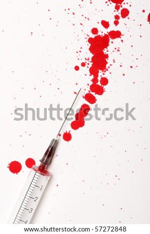 Blood with syringe - stock photo