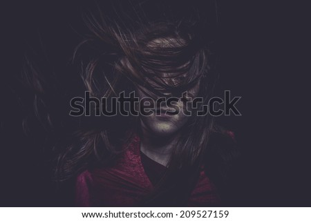 Blood, Young girl with hair flying, concept nightmares - stock photo