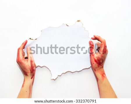 bloodied woman's hands holding an old white sheet on a white background to the topic of Halloween