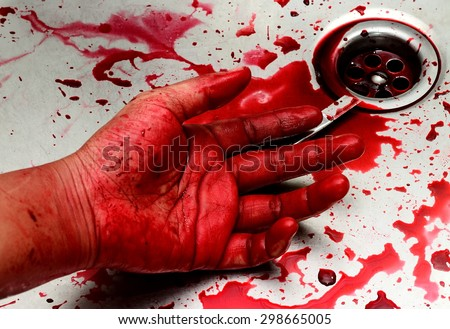Bloody box cutter and hand in sink with flowing red blood. Murder concept background - stock photo