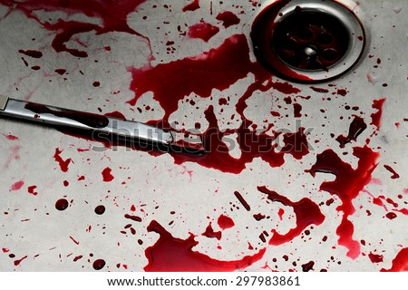 Bloody box cutter in sink with flowing red blood. Murder concept background - stock photo