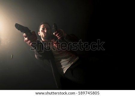 bloody gangster in action - stock photo