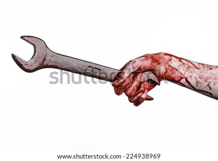 bloody hand holding a big wrench, bloody wrench, big key, bloody theme, halloween theme, crazy mechanic, murderer, psycho, violence, zombies, white background, isolated, revolution - stock photo