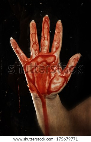 bloody hand on glass - stock photo