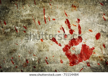 Bloody hand print and blood splatter on a grungy wall.