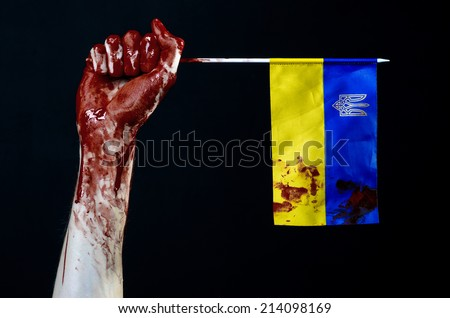Bloody hands, the flag of Ukraine in the blood, revolution in Ukraine, Black background - stock photo
