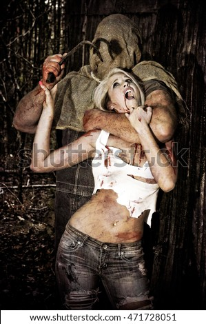 Bloody Horror scene of a Hooded man attacking a young woman