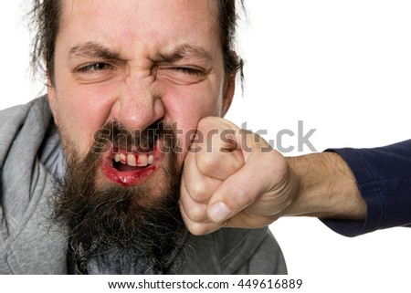 bloody man beeing slapped with a fist
