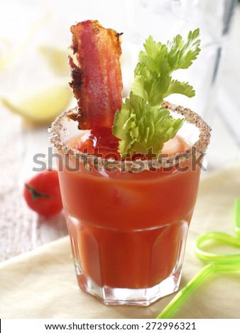 Bloody mary cocktail with bacon and celery, selective focus - stock photo