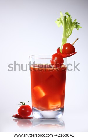 Bloody Mary or tomato juices on gray background - stock photo
