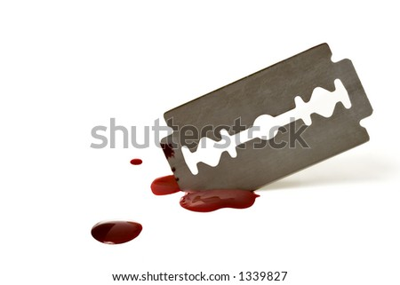 Bloody razor blade isolated over a white background - stock photo