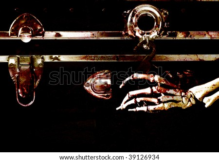 bloody skeletal hand reaching for padlock on trunk - stock photo