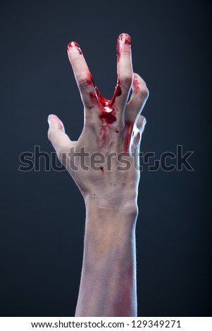 Bloody zombie hand, studio shot - stock photo
