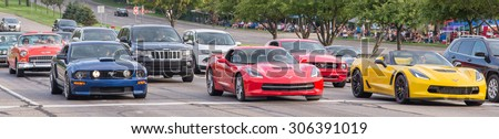 BLOOMFIELD HILLS, MI/USA - AUGUST 14, 2015: Two modern Ford Mustangs, two modern Chevrolet Corvettes, and a classic 1955 Chevrolet Bel Air car at the Woodward Dream Cruise.