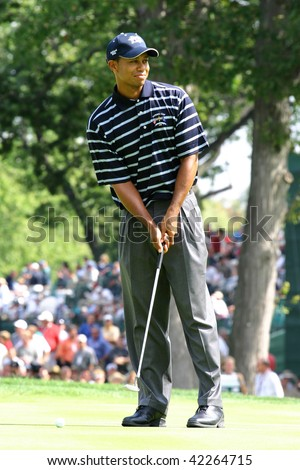 BLOOMFIELD HILLS, MICHIGAN - SEPTEMBER 9: Professional golfer Tiger Woods competes in the 2004 Ryder Cup on September 9, 2004 in Bloomfield Hills, Michigan.