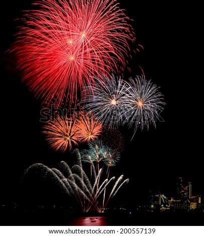 Blooming firework mixed color of international firework festival  - stock photo