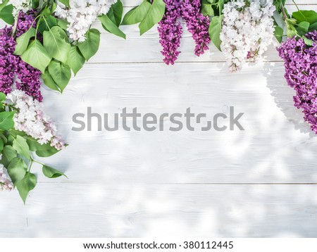 Blooming lilac flowers on the old wooden table. - stock photo
