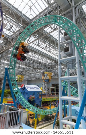 BLOOMINGTON, MN - JULY 06,  - Mall of America on July 06, 2013  in Minnesota. Currently, the mall of America has 23 empty stores, making it 4% vacant. - stock photo