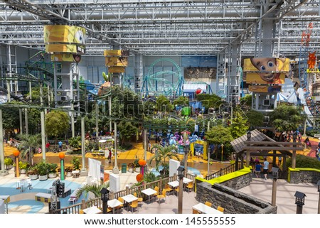 BLOOMINGTON, MN - JULY 06,  - Mall of America on July 06, 2013  in Minnesota. More than 530 stores are arranged along 3 levels of pedestrian walkways.  - stock photo