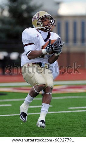 BLOOMSBURG, PA - NOVEMBER 6: Kutztown University running back Kendall Coleman (#1) catches and cradles a kickoff in a game November 6, 2010 in Bloomsburg, PA - stock photo