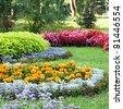 Blossoming colorful flowerbeds in summer city park - stock photo