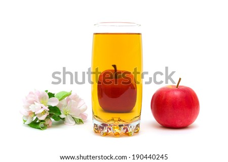 blossoms of apple, a glass of juice and ripe red apple isolated on a white background. horizontal photo. - stock photo