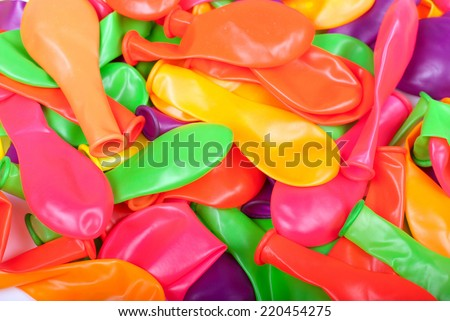 blow away a lot of colorful balloons - stock photo