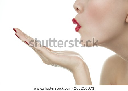Blowing a kiss - stock photo