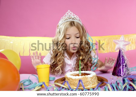 blowing candles birthday party little blond happy girl - stock photo