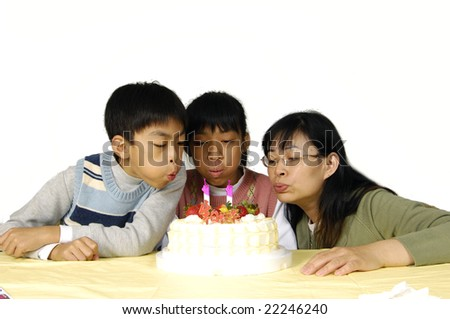 blowing out candles - stock photo