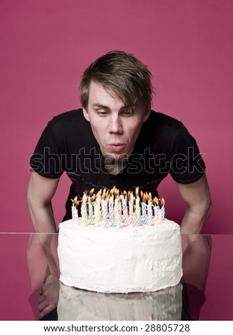 Blowing out candles on a birthdaycake - stock photo