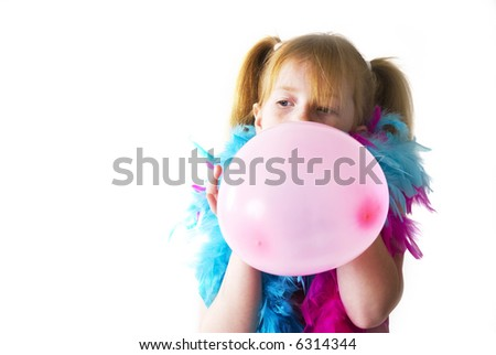 Blowing the pink balloon for the birthday party - stock photo