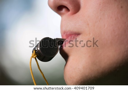 Blowing the whistle - stock photo