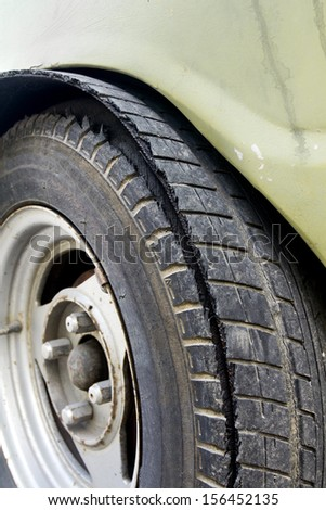 Blowout tire of old car - stock photo