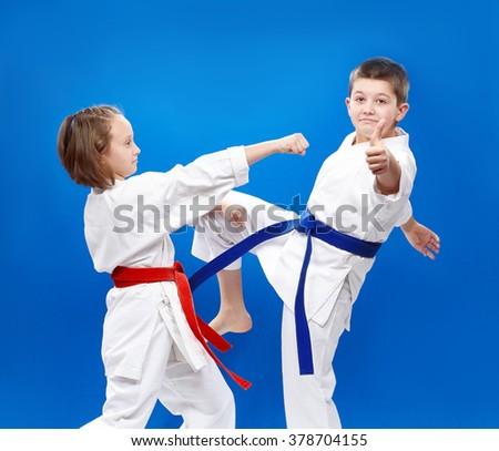 Blows and blocks karate are training children in karategi - stock photo