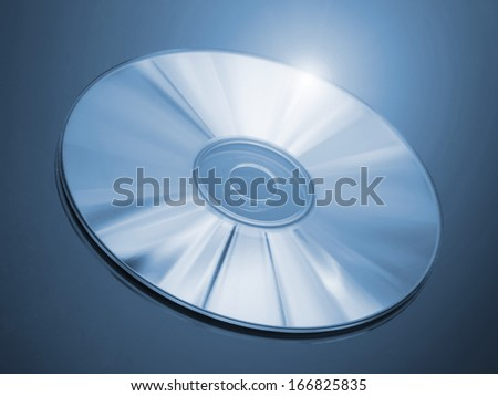 Blu-ray disc on a blue background - stock photo