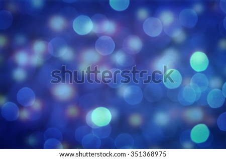 Blue abstract background. Blurred and glowing lights.