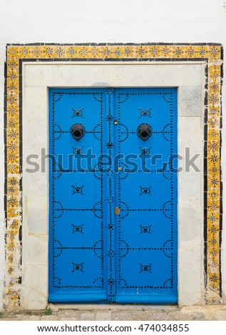 Blue aged door with ornament and tiles from Sidi Bou Said in Tunisia