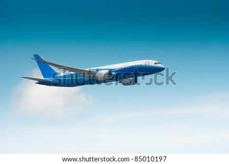 Blue airplane in the sky - stock photo