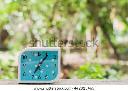 blue alarm clock on bokeh background,Close up blue alarm clock - stock photo