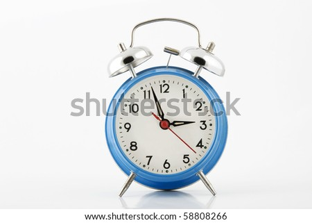 blue alarm-clock with silver bell on white background - stock photo