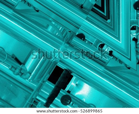 Blue aluminum background. Metal pipes and abstract technological components. industrial concept.
