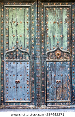 Blue ancient wooden door background with rusty decorative elements  - stock photo