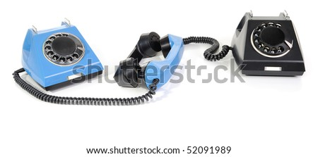 blue and black phones with the taken off handset on a white background - stock photo