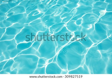 Blue and bright water in swimming pool