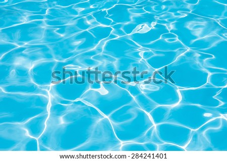 Blue and bright water surface in swimming pool - stock photo